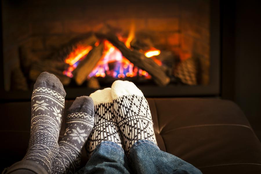 bigstock-feet-warming-by-fireplace-55274456